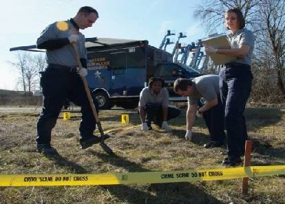 Criminology workers at crime scene